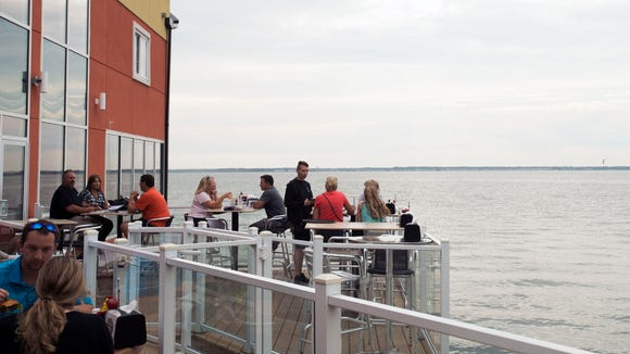 Patrons enjoy a bayside dinner outside the 45th Street Taphouse in Ocean City.