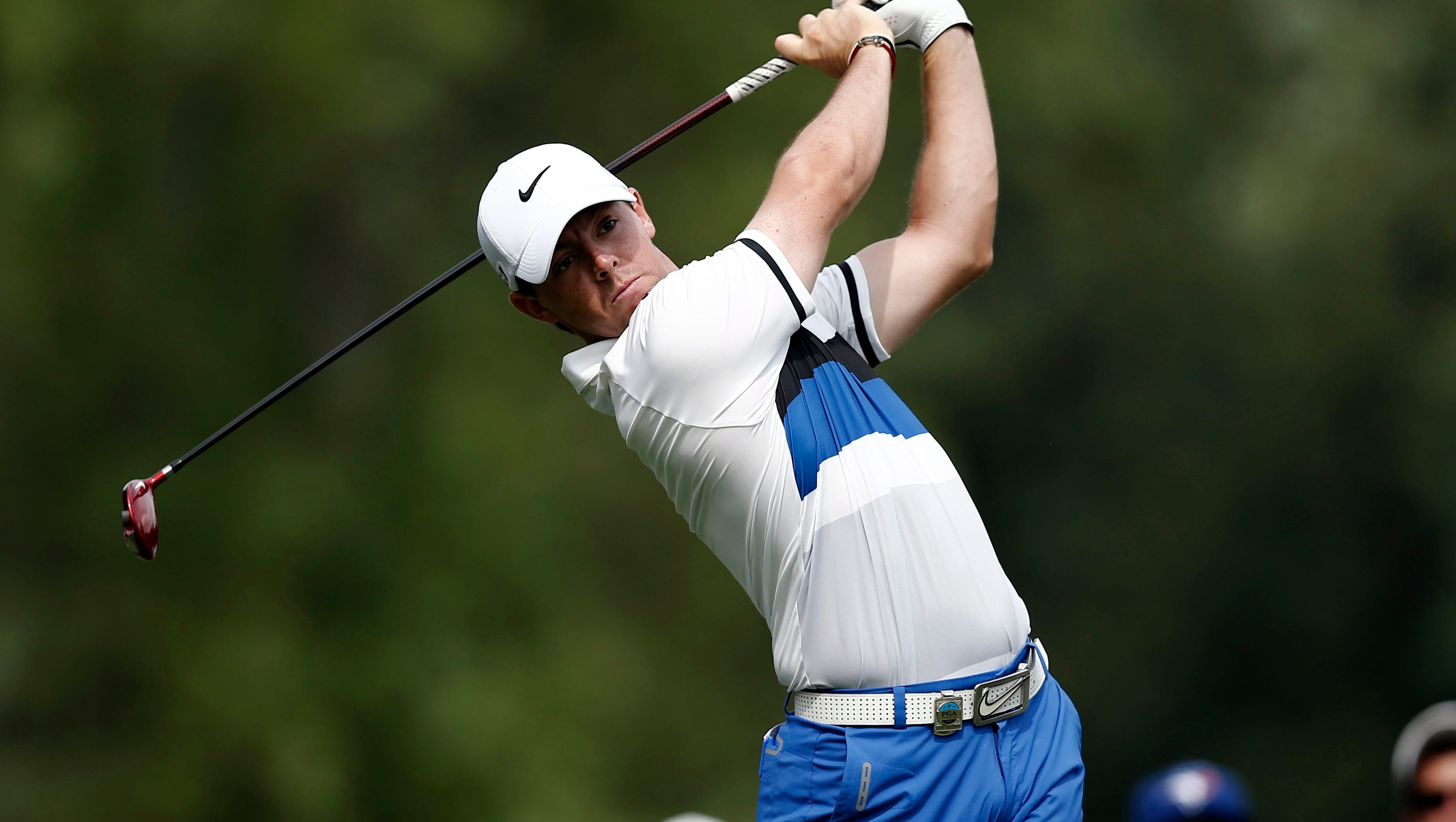 Rory McIlroy tees off on the 9th tee during the first round of the 95th PGA Championship at Oak Hill Country Club.