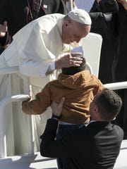 A young Juárez resident broke through the line to hug the pope Wednesday at the airport.