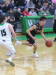 Pleasant's Nick Kimmel dribbles the ball while playing