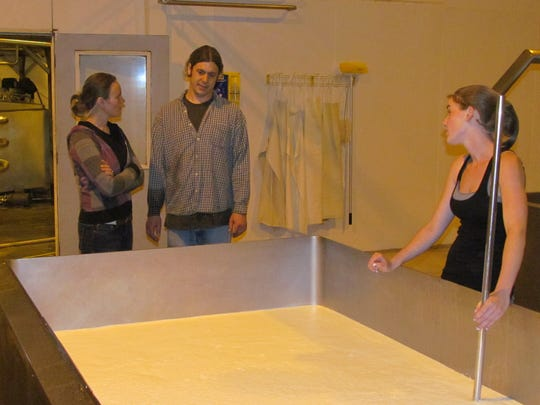 Lisa Parker of Salem (left) and Brian and Kate Humiston tend to a batch of mozzarella cheese at Scio location in 2013.