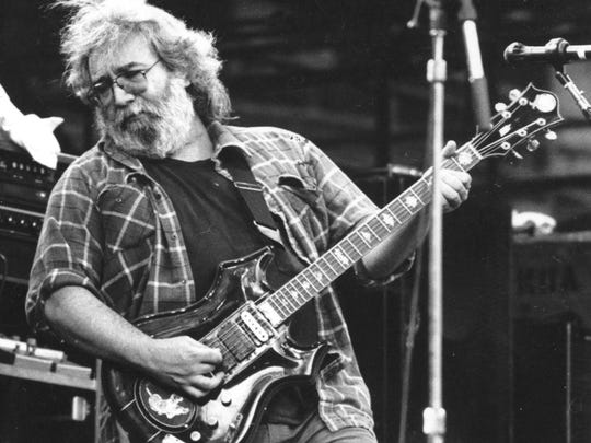 """Jerry Garcia is seen playing his """"Tiger Guitar"""" at Oakland Coliseum in 1987."""