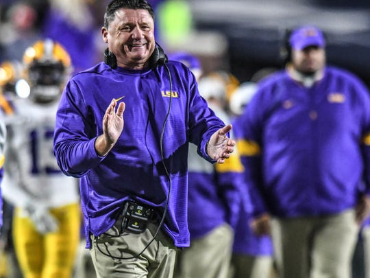 LSU coach Ed Orgeron smiles following an LSU touchdown against Mississippi during an NCAA college football game Saturday, Nov. 16, 2019, in Oxford, Miss. (Bruce Newman/Oxford Eagle via AP)