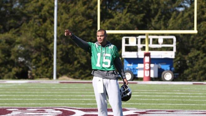 Mississippi State senior quarterback Dak Prescott addressed his teammates after Saturday's practice.