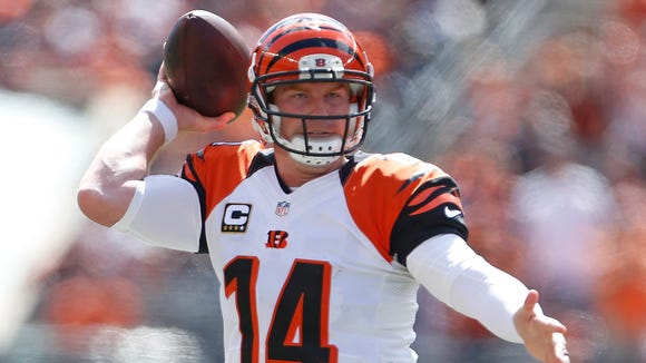 Cincinnati Bengals quarterback Andy Dalton (14) throws against the Atlanta Falcons during the first quarter of their game played at Paul Brown Stadium in Cincinnati, Ohio Sunday September 14, 2014. The Enquirer/Gary Landers