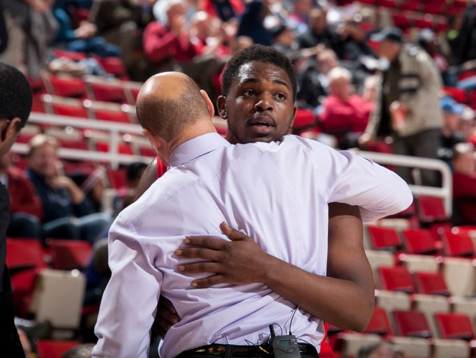 Detroit guard Carlton Brundidge gets a hug from head