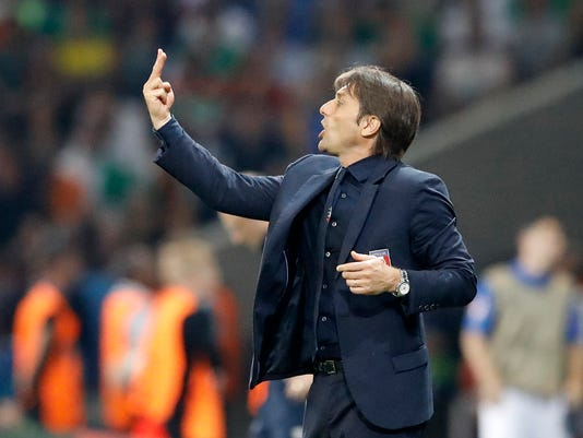 Italy's coach Antonio Conte gestures during the Euro 2016 Group E soccer match between Italy and Ireland at the Pierre Mauroy stadium in Villeneuve d'Ascq, near Lille, France, Wednesday, June 22, 2016. (AP Photo/Frank Augstein)