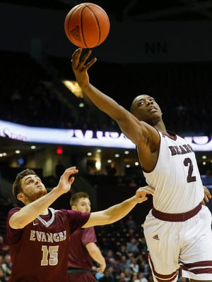 Reggie Scurry (2) goes after a rebound during the Missouri State Bears win over the Evangel Crusaders at JQH Arena on Friday, Nov. 24, 2017.