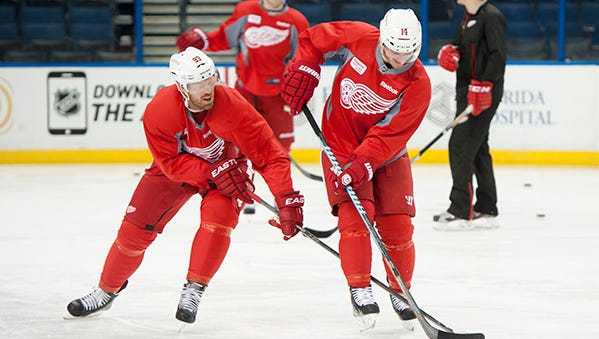 Johan Franzen, left, and Gustav Nyquist go after the puck during the morning skate on Thursday ahead of Game 1.