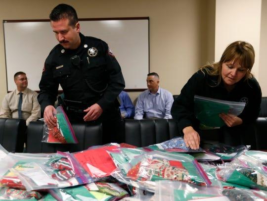 Greene County Sheriff's Deputies grab stockings stuffed