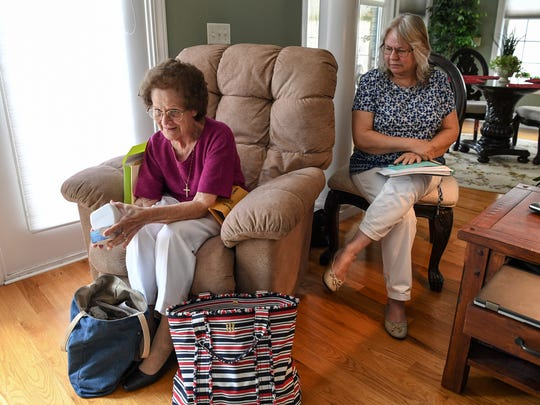 Anne Harrell, left, sitting near her daughter, Denise