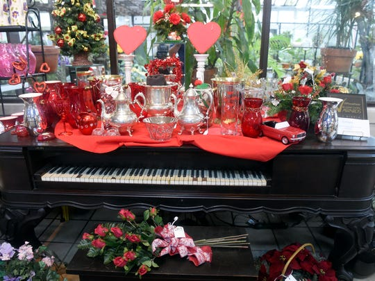 Valentine's Day items are displayed on top of the 1879 Decker & Son square grand piano owned by Joan Schmitt's great-great-grandmother at The Flower Shop on Kentucky Avenue in Evansville Friday.  Schmitt is retiring after running the family owned business that has been at the same location for 140 years.  All items at the shop have been heavily discounted and the historic business is expected to close at the end of January.  This will be the first time in ages that the business will not be open for Valentine's Day.