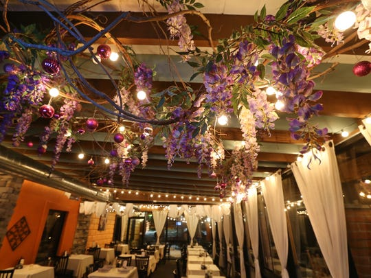 Wisteria vines hang from the ceiling in one of the