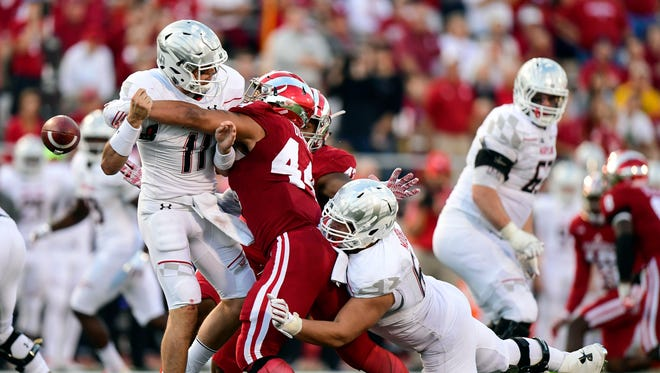 IU linebacker Marcus Oliver forces a fumble during the Hoosiers' win over Maryland on Saturday.