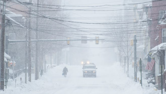 A person walks down Cumberland Street in Lebanon as Winter Storm Stella slammed Lebanon County on Tuesday, March 14, 2017. The storm was predicted to dump more than a foot of snow in the area.