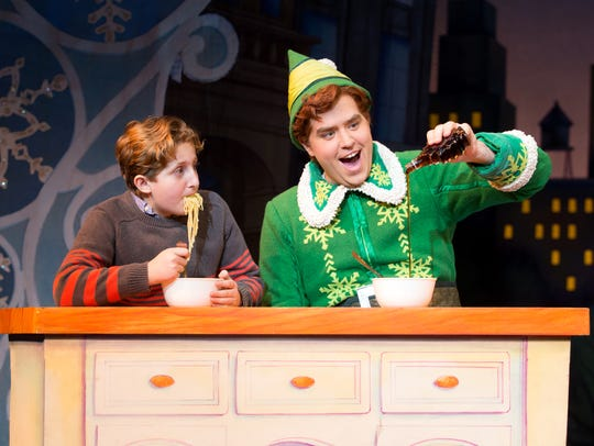 "Sam Hartley, right, stars as Buddy in the musical ""Elf"""