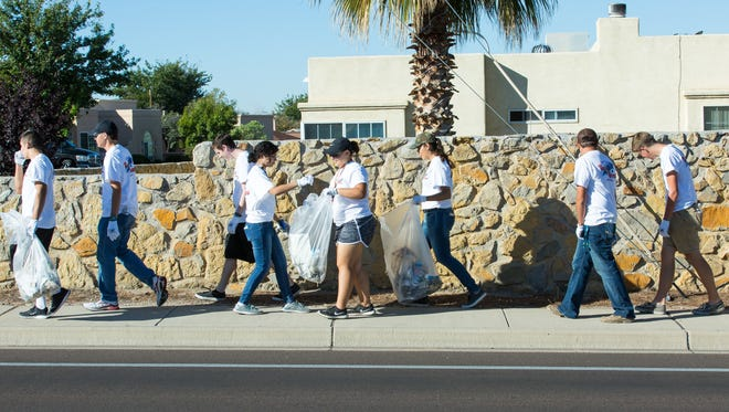 Mayor's Top Teens pickup trash near the Triviz walking path on Saturday, October 15, 2016, during the 22nd annual Toss No Mas campaign hosted by Keep Las Cruces Beautiful and New Mexico Clean and Beautiful. Last year, 1,100 volunteers from 65 local groups and organizations collected more than 15 tons of litter during the event.