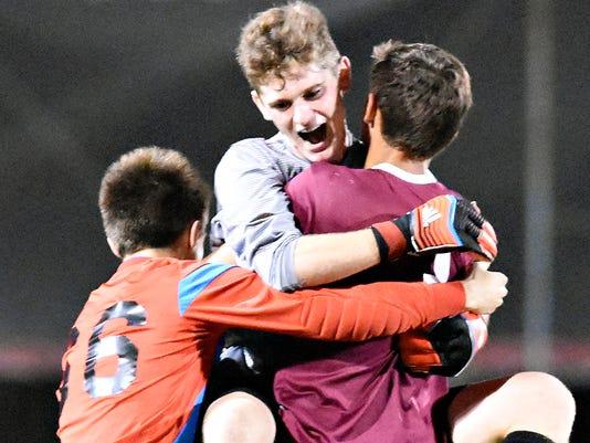 Gettysburg celebrates after winning the  York-Adams League boys soccer championship game 1-0 against Central York in Glen Rock, Pa. on Thursday, Oct. 22, 2015. Dawn J. Sagert - dsagert@yorkdispatch.com