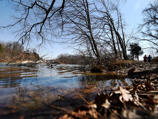 Hikers walk on trail no.2  in  William H. Kain County