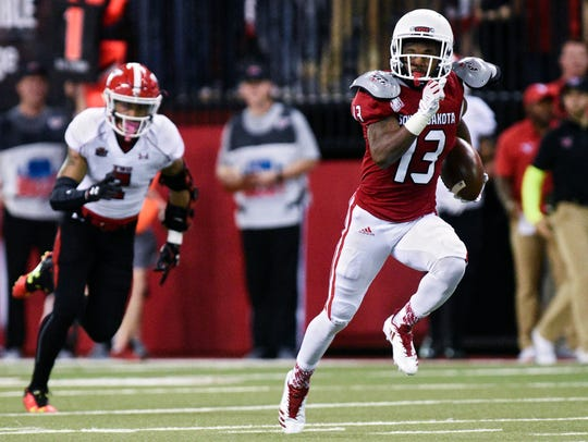 Shamar Jackson (13) caught 53 passes last year for the Coyotes and returns as the top receiver for USD this  fall.