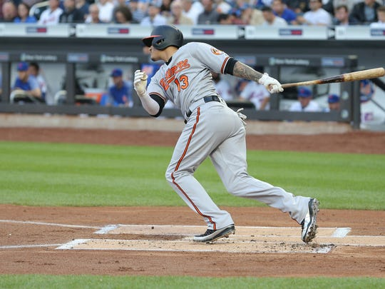 Baltimore Orioles shortstop Manny Machado (13) follows through on an RBI single against the New York Mets during the first inning at Citi Field.