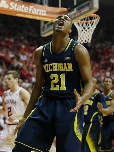 Michigan's Zak Irvin reacts after missing a shot and
