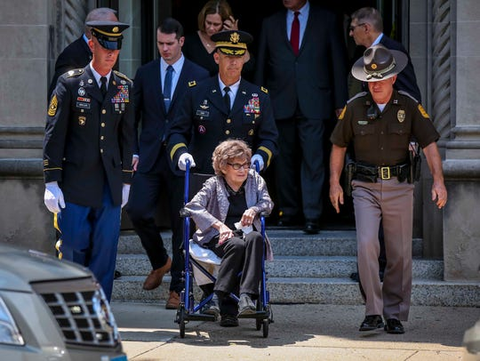 Former Iowa First Lady Billie Ray leaves after the