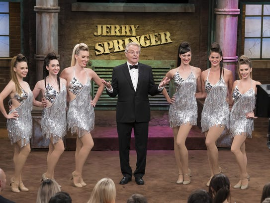 Host Jerry Springer, center, appears during taping