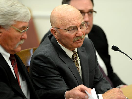 Joseph Campbell answers questions from District Court