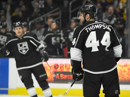 Los Angeles Kings center Nate Thompson, right, celebrates his goal as defenseman Dion Phaneuf skates out to congratulate him during the second period of an NHL hockey game against the Columbus Blue Jackets, Thursday, March 1, 2018, in Los Angeles. (AP Photo/Mark J. Terrill)