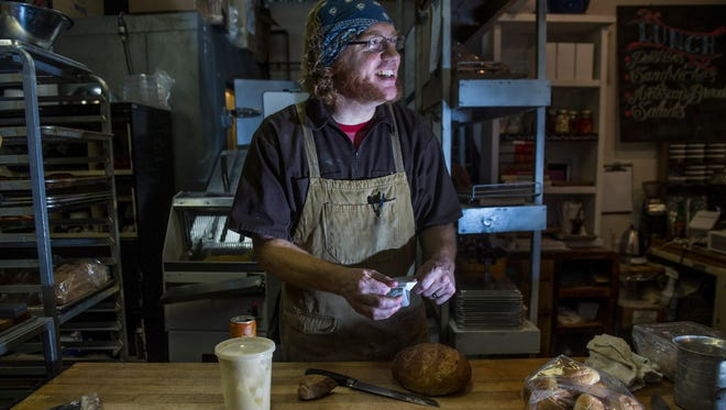 Chef Sam Tucker of the The  Village Bakery and Provisions works in his kitchen in the Nashville Farmers' Market.