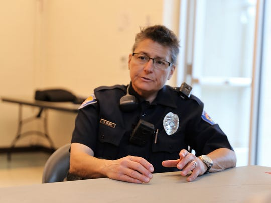 District Coordinator Unit Officer Michele DeLese of the Farmington Police Department speaks to community members during a community watch meeting on Thursday at the Sycamore Park Community Center.