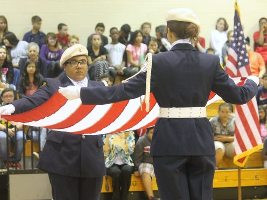 Alamogordo High School ROTC performs a flag folding ceremony in honor of Emily Lozano.