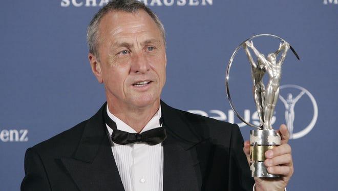 Johan Cruyff holds his lifetime achievement award during the Laureus World Sports Awards in Barcelona, Spain.