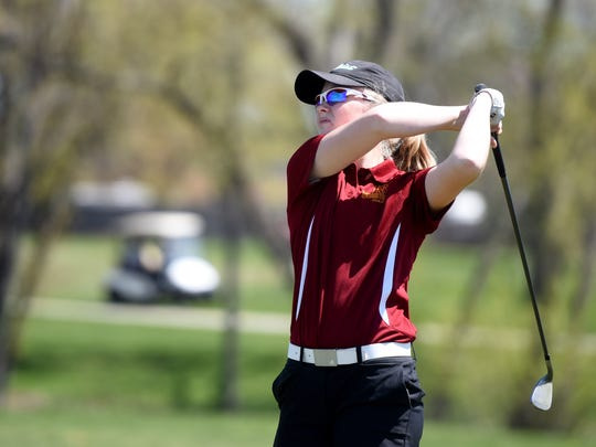 Roosevelt's Natalie Poppens tees off at hole 8 during