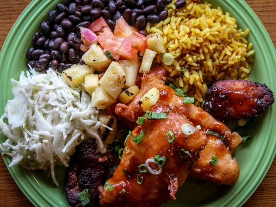 The Local Plate at Fins Tropicali Cuisine in Bradley Beach is made with spiced battered cod served with wasabi slaw, grilled pineapple pico and sweet plantains. TOM SPADER/STAFF PHOTOGRAPHER