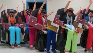 Staff at Southwest Middle School used a costume contest as a means to raise money for needy families.