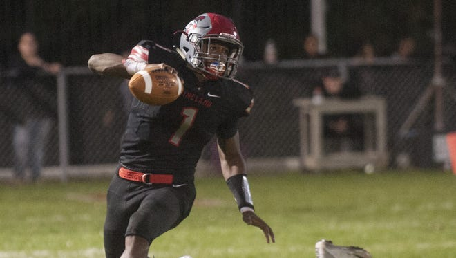 Vineland quarterback Isaih Pacheco breaks a tackle during a loss to St. Augustine last week.