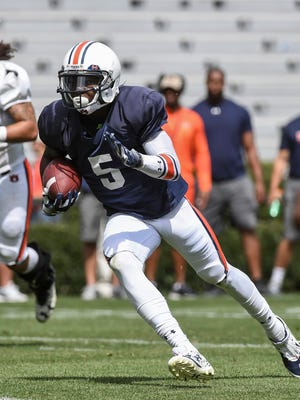 Auburn wide receiver John Franklin III (5) runs with the ball during the spring football scrimmage on Saturday, March 25, 2017 in Auburn, Ala.