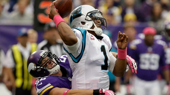 Carolina Panthers quarterback Cam Newton, right, is sacked by Minnesota Vikings outside linebacker Chad Greenway in 2013. He has compiled 18 sacks in 11 season.s