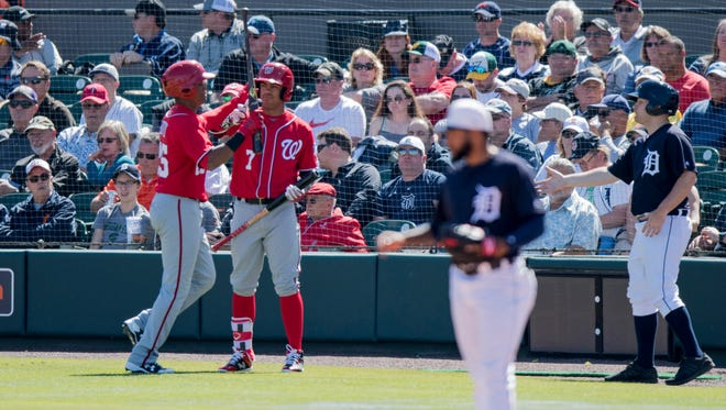 Juan Soto, left, got a brief look in spring training. Little did the Nationals know they'd need the 19-year-old in their outfield this season.