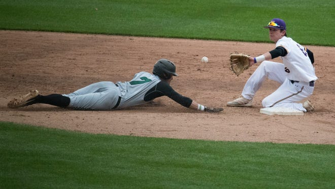 Wilmington's Kendall Small (7) dives back to second base during the Bill Giles Invitational against West Chester last month at Citizens Bank Park. Wilmington defeated West Chester 6-1.