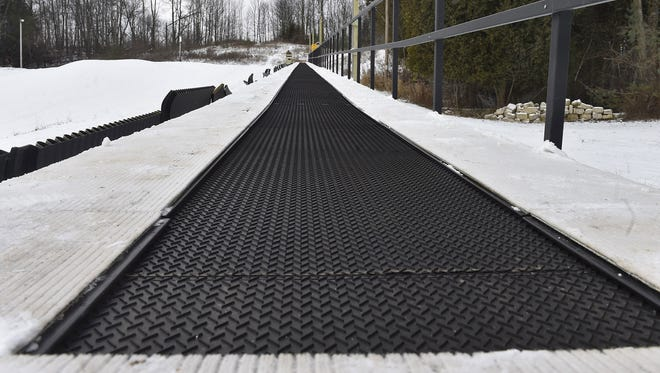 The new Magic Carpet conveyor lift will bring snow tube tube riders to the top of the hill this season at Winter Park in Kewaunee.