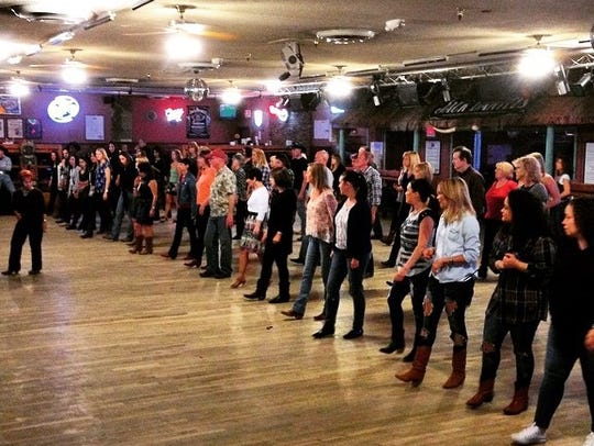 Line dancing classes are offered three times a week.