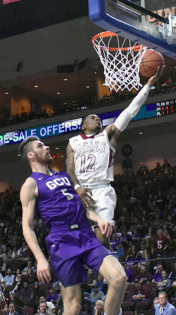 New Mexico State's AJ Harris goes in for a easy layup