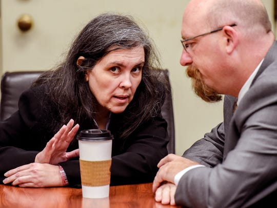 Louise Turpin, left, talks with her attorney Jeff Moore