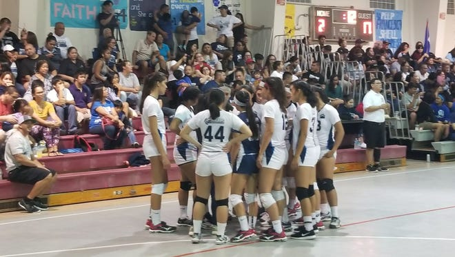 Cougars huddle up during a timeout. They lead the Royals, 22-17, in the first set.