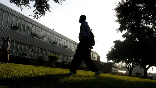 Shaquille Johnson makes his way across the front lawn of Booker T. Washington High School in a Times file photo.