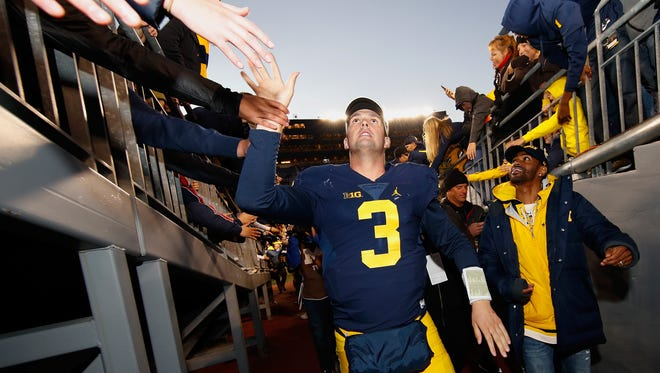 Michigan Wolverines QB Wilton Speight high-fives fans after a 41-8 win over Illinois on Oct. 22, 2016 at Michigan Stadium.