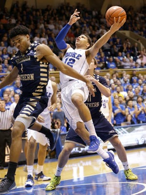 Duke's Derryck Thornton (12) drives to the basket during the second half against Georgia Southern. Duke won 99-65.